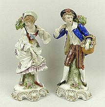 A pair of Continental porcelain figures of flower