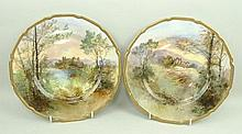 A pair of Royal Doulton porcelain plates painted by J Hughes