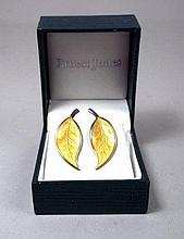 A pair of David Andersen silver and yellow enamel leaf shape