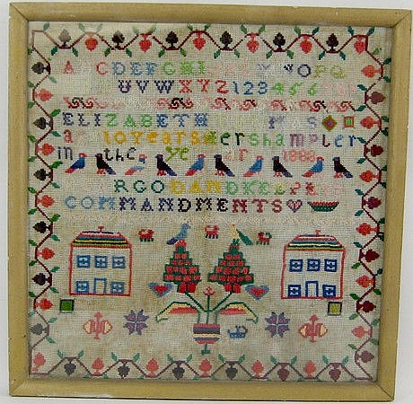A 19th century woolwork needlework sampler, signed