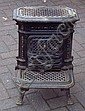 A cast iron wood burning stove.
