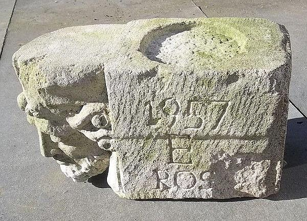 A composition stone corbel of a king, 39 by 18 by