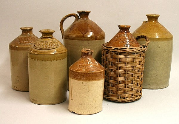 A quantity of stoneware flagons, comprising;