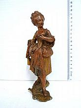 Lead figurine, woman in periodic dress