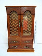 Jewelry box, in the shape of a cabinet with