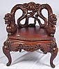Ornately carved Oriental dragon chair