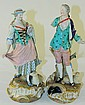 Pair of hand painted Meissen figurines