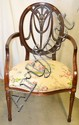 Upholstered Arm Chair with Carved Back