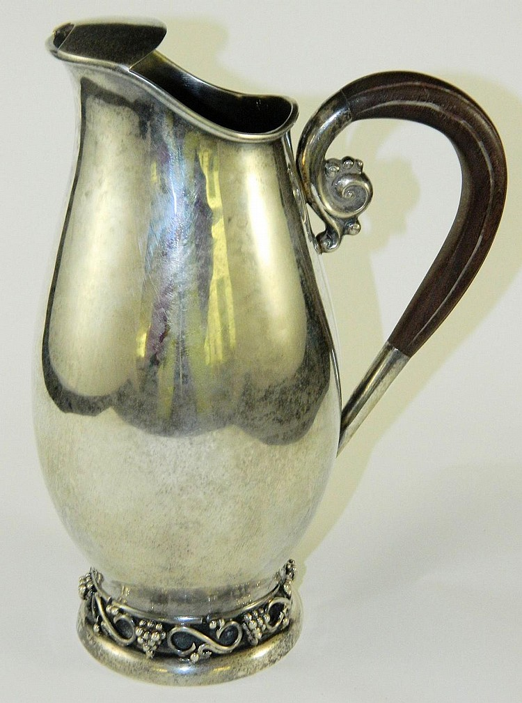Mexican silver pitcher with wooden handle