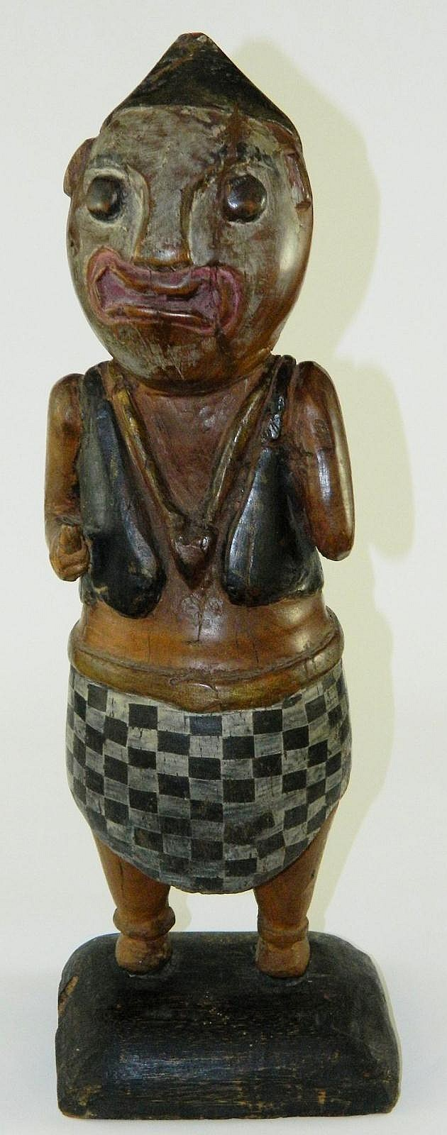 Wood carved and decorated folk art figure