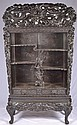 Oriental etagere cabinet with dragon carvings