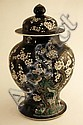 A large Oriental baluster shape vase on a black