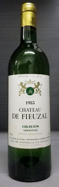 1 Bouteille FIEUZAL BLANC Niveau mi épaule.  Level upper mid shoulder.  1985