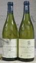 2 Bouteilles PULIGNY-MONTRACHET CLOS DU CAILLERET - DOMAINE DES LAMBRAYS Etiquette légèrement tachée, 1 légèrement abîmée, fanée.  Labels ligthly stained, 1 slightly damaged, faded.  2000