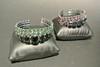 YVES SAINT LAURENT Rive Gauche par GRIPOIX  Deux bracelets Prototypes en métal noirci entièrement pavés de strass roses, bleus, verts et noirs    Diamètre : 7 cm (non signé)