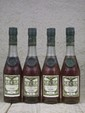 4 3 cl. COGNAC A.E. DOR - COLLECTION DE 4 FLACONS Composition : 1 A.E.DOR Fine Champagne cuvèe RARE, 1 A.E. DOR Cognac Napoleon, 1 A.E. DOR Fine Champagne X.O., A.E. DOR Grand Champagne RESERVE n° 7 Composed of 1 A.E.DOR Fine Champagne cuvèe RARE, 1