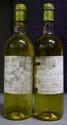 2 BOUTEILLES DOISY DAËNE étiquettes tachées, legèrement abîmées. Labels stained, slightly damaged. 1970