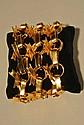 VALENTINO Couture Large bracelet manchette en métal doré, constitué de rubans entrelacés - Dimensions : 22 x 6 cm - Size : 8,6 x 2,3 in. (très bon état/very good condition)