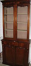 A Victorian small form two height bookcase