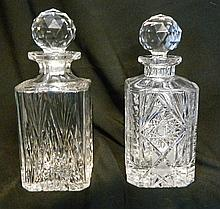Two similar crystal decanters. height 26 cm
