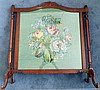 An Edwardian Style Timber Fire Screen with inset handmade tapestry depicting roses & hydrangeas