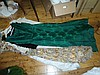 Six assorted women's evening clothes including emerald brocade dress