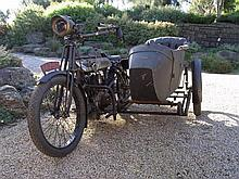 A 1914 Victor Motorcycle and sidecar