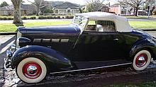A 1937 Packard 120 Straight 8 Rumble-Seat Convertible Coupé