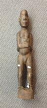 A carved timber tribal figure