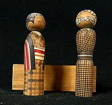 Two Japanese Kokeshi dolls in wooden box
