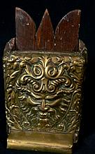 An antique brass and timber phamplet holder