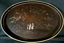 An oval Chinese black lacquer tray with figures, mountains trees and house