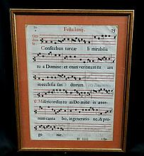 A framed antique missal page