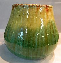 A John Campbell green pottery vase signed and dated 1934