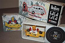A Corgi Classics The Beatle Collection; Newspaper, Taxi & Figure (Rita Meter Maid and Meter) and The Yellow Submarine