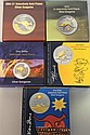 Five assorted selectively gold plated $1 silver kangaroo coins