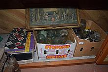 Contents to cupboard including glass jars, bottles and games