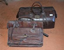 A leatherette Gladstone style bag with another