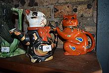 Two novelty cat teapots