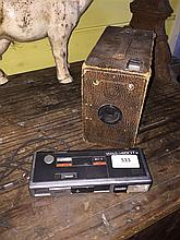 A Box Ensign camera and a Minolta 460T pocket camera