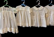 A Group of Four Vintage Baby Dresses