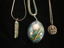 Three Necklaces including an Enamel Flower Pendant an Indian Elephant and New Zealand Jade Pendant