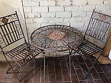 An Ornate Outdoor Table and Chair Setting