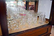 A part shelf of assorted crystal and glassware