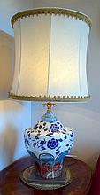 A pair of Italian stone and ceramic table lamps and shades