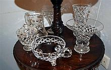 Six assorted crystal vases and jugs