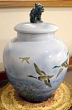 A Falcon Ware Lucknow lidded jar decorated with flying ducks. 48cm (AF)