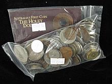 A collection of coins including Australias first Holey Dollar and a Tudor Coin souvenir
