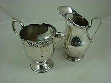 Two silver plated water jugs