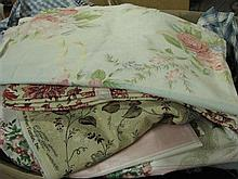 A box of assorted fabrics